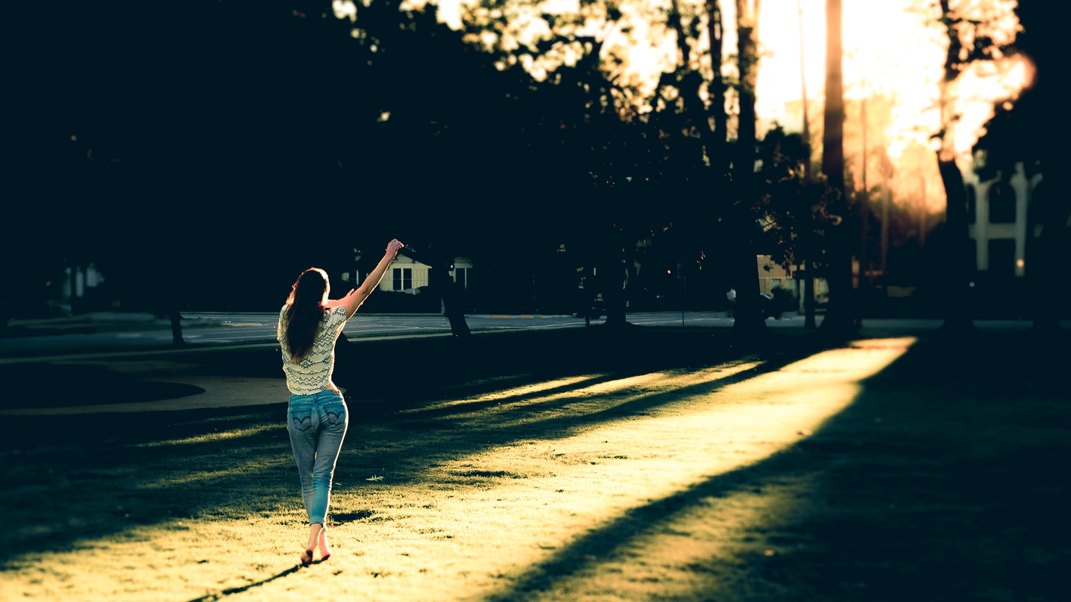 woman dancing in the sunset in balboa park by Ian Meyers