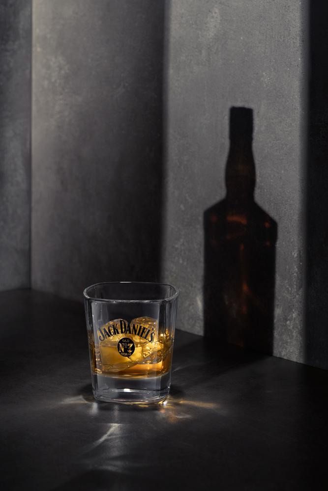 Jack daniels glass and shadow by Piotr Maksymowicz