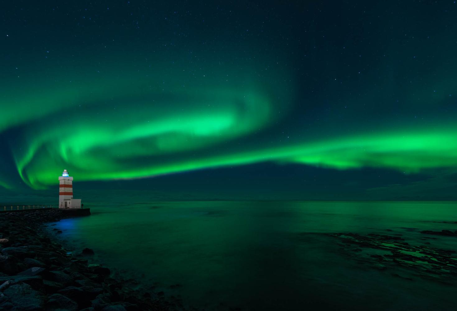 Green over Garðskagi lighthouse by Þorkell Sigvaldason