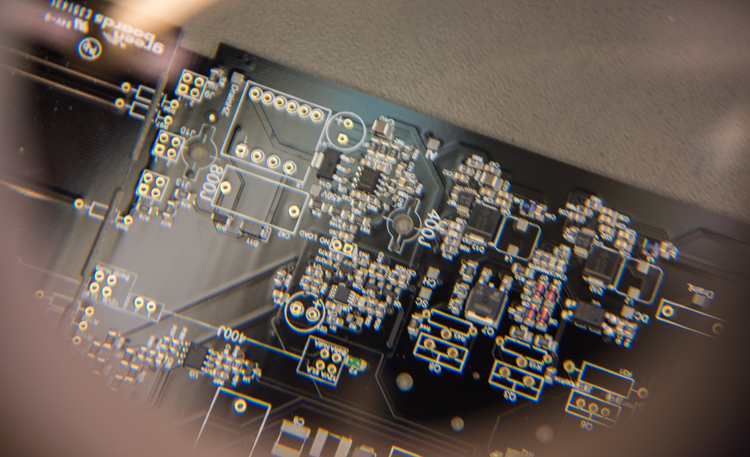Examining a printed circuit board by Will Prentice