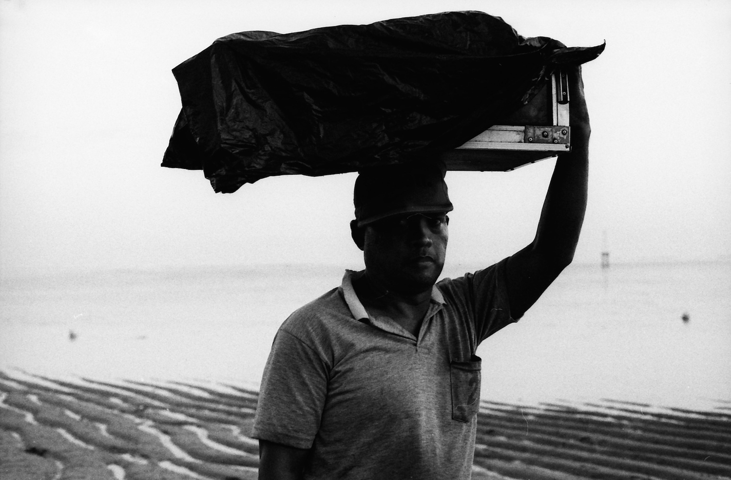 Portrait of a food vendor in the last light of the day by Mark Chaves