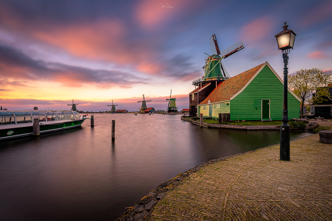 Majestic sunset by the windmill village. by Costas Ganasos