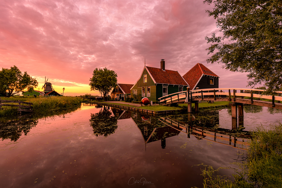 A memorable sunset at the windmill village by Costas Ganasos