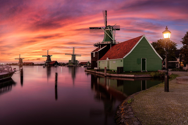 Sunset by the windmills of Zaanse Schans by Costas Ganasos