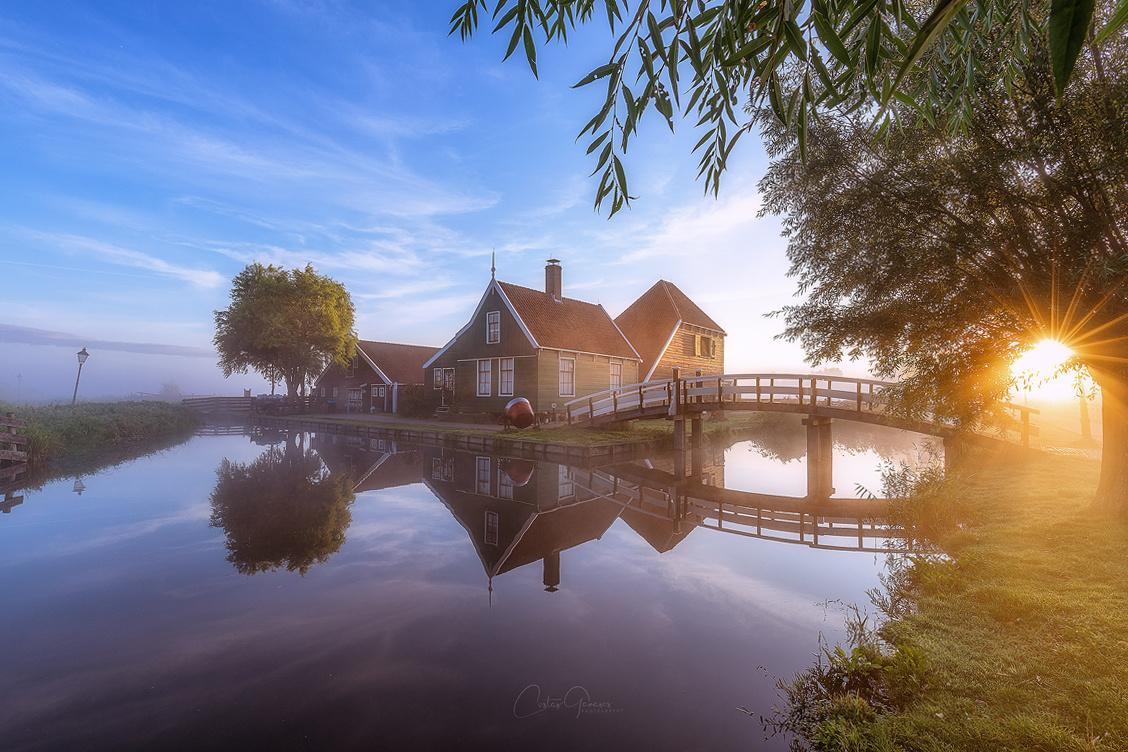 A foggy sunrise in Zaanse Schans by Costas Ganasos