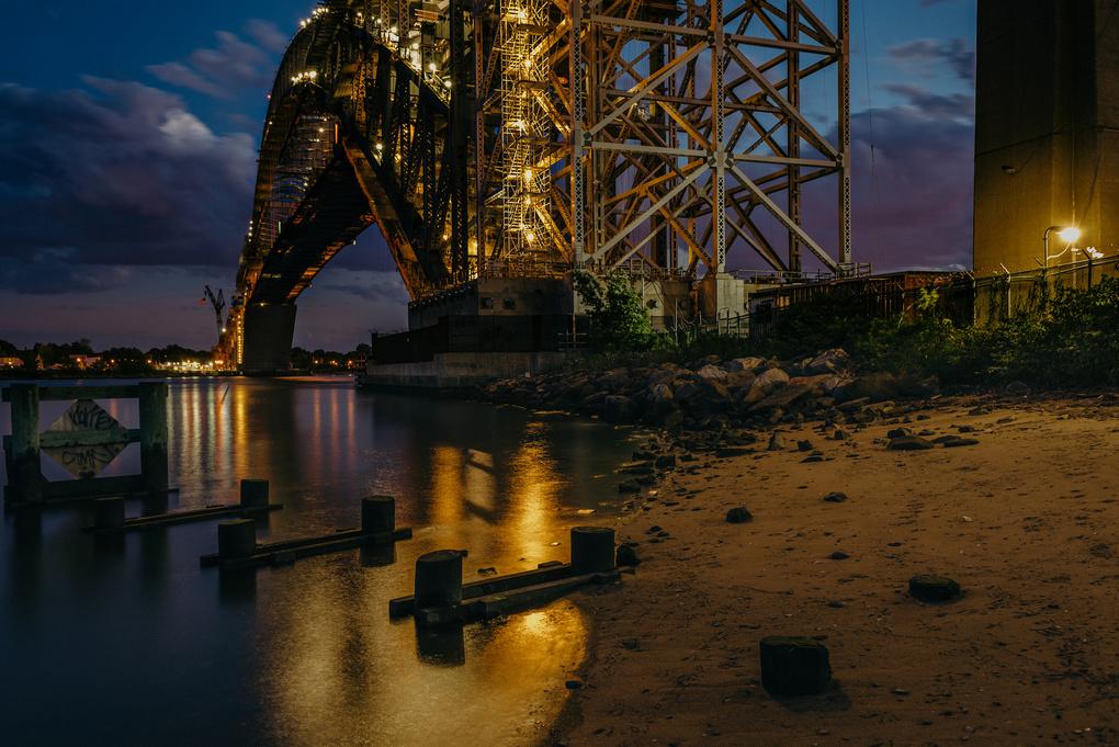 Beach and Pilings By Bayonne Bridge by Stephen Fretz