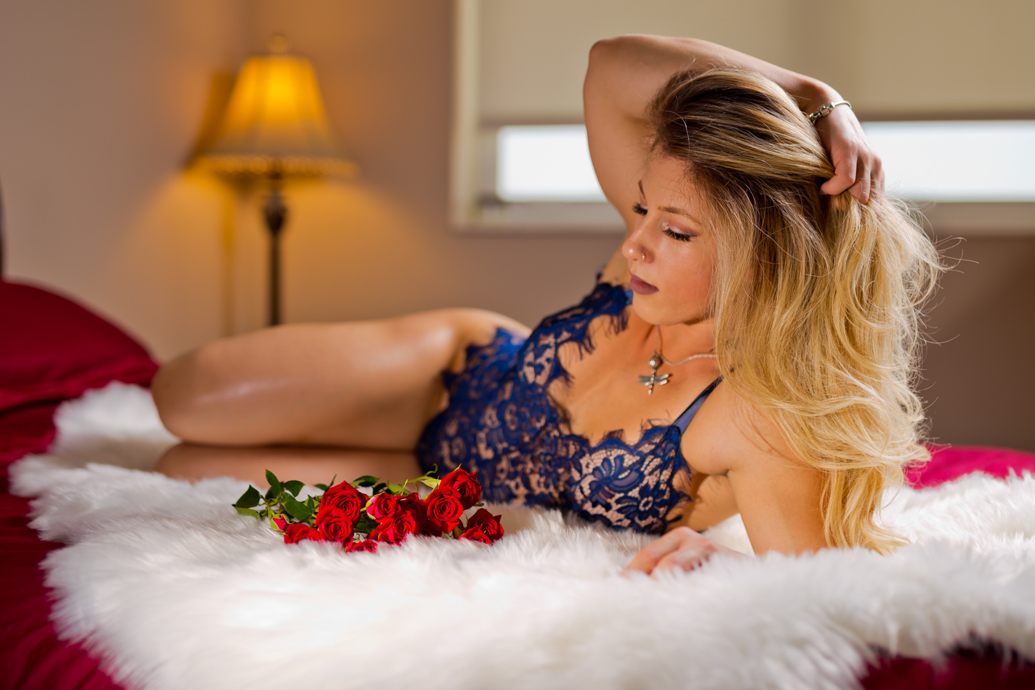 In bed with roses by John Miller