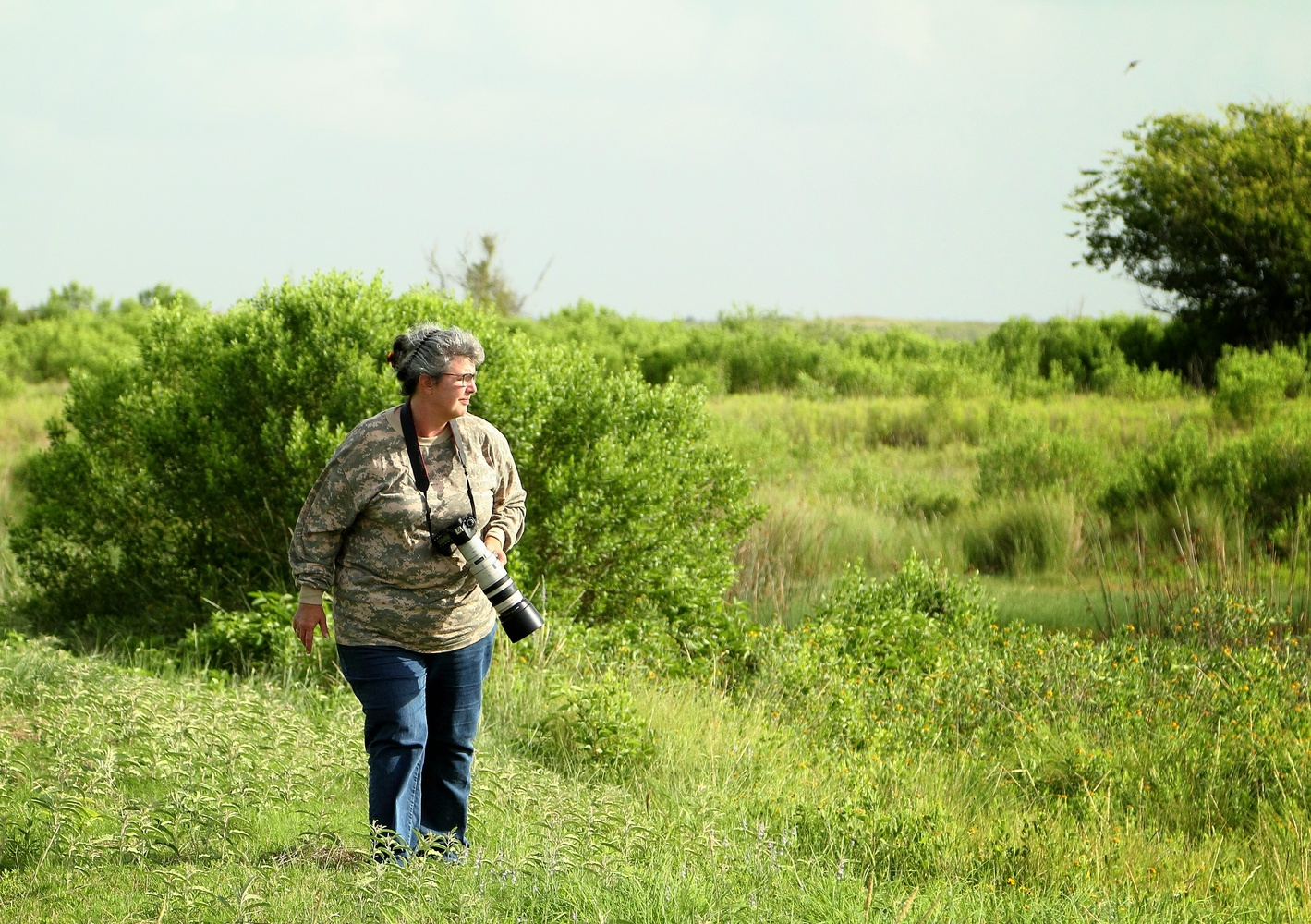 Nature photographer in the wild by Dudley Didereaux