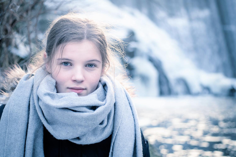 Teenager exploring icy waterfall by Arild Hagen