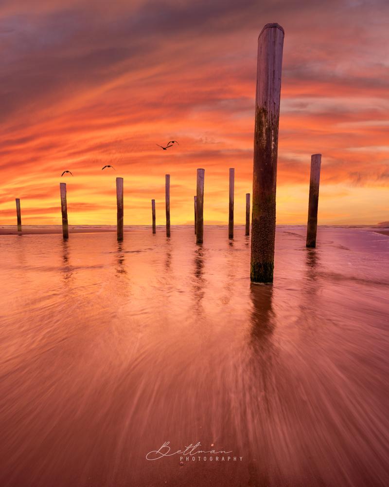 Burning sunset at sea by Matthijs Bettman