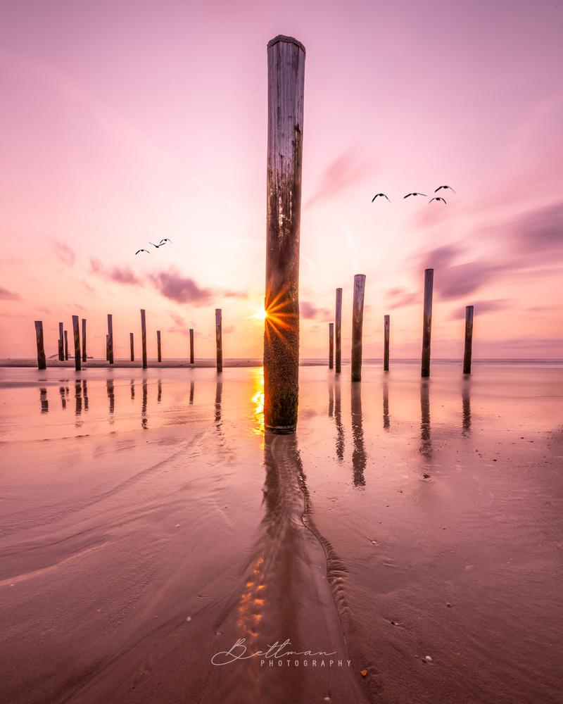 Pole at the beach by Matthijs Bettman