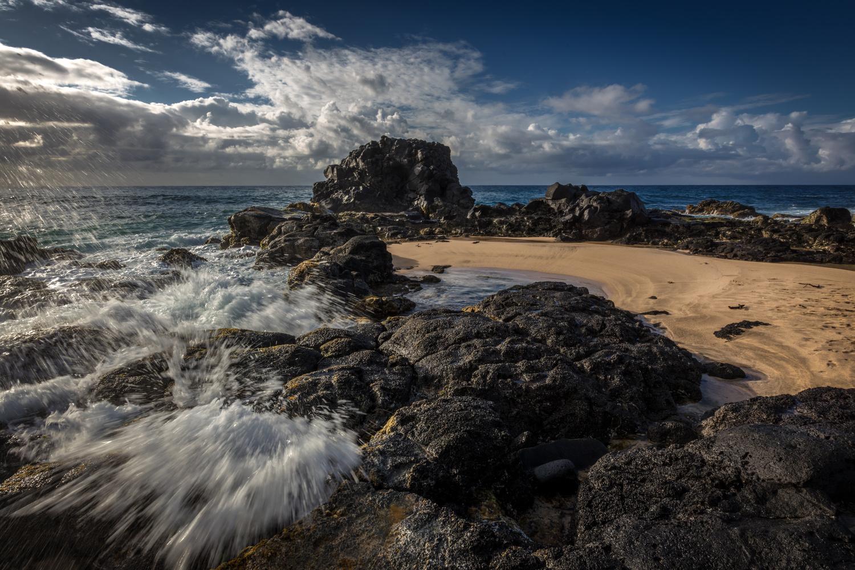 wet rocks by michele tassinari