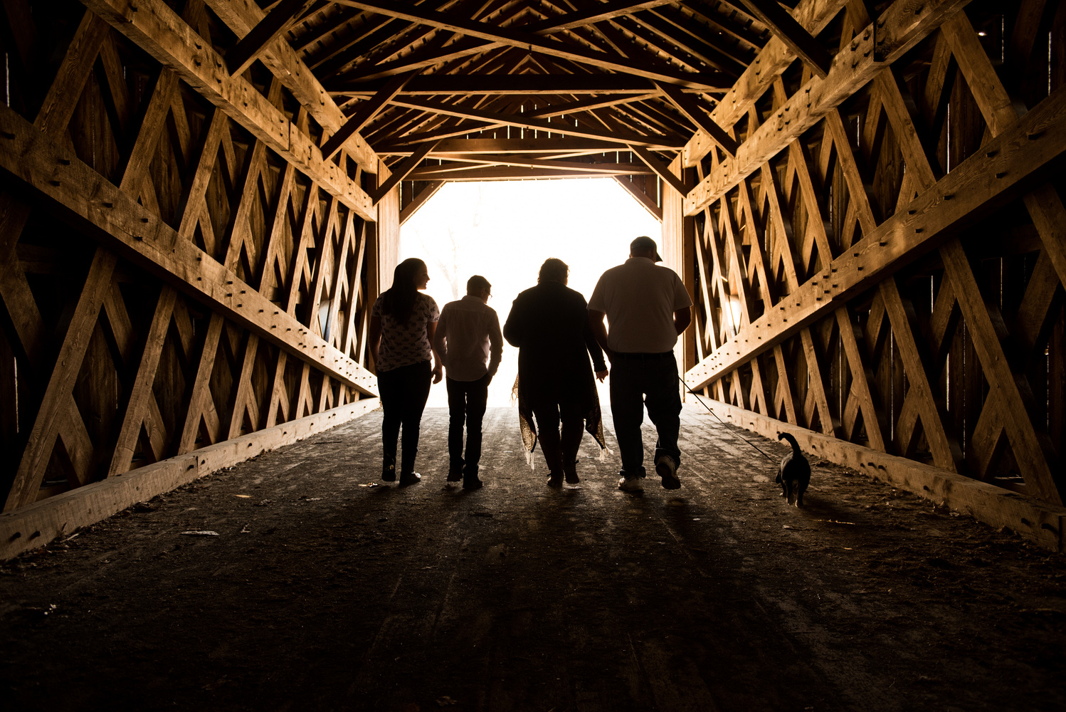 Family Portrait in a Covered Bridge by James Fairfield