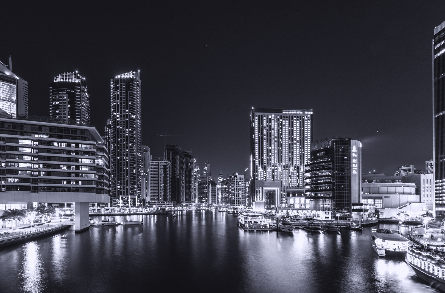 Dubai Marina at night in Blue 1 by David Evans
