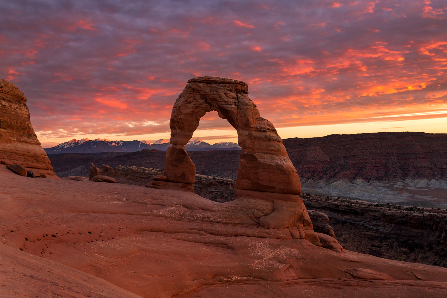 Fiery Sky Above Delicate Arch by Nick Souvall