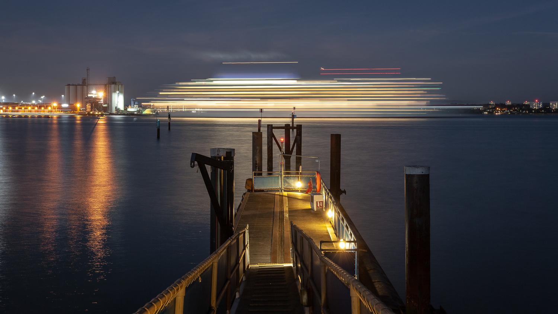 Light trails on the sea by Dorian Drozdowski