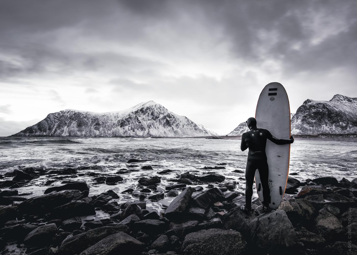 Surfer | Skagsanden Beach - Lofoten by Aris Christou