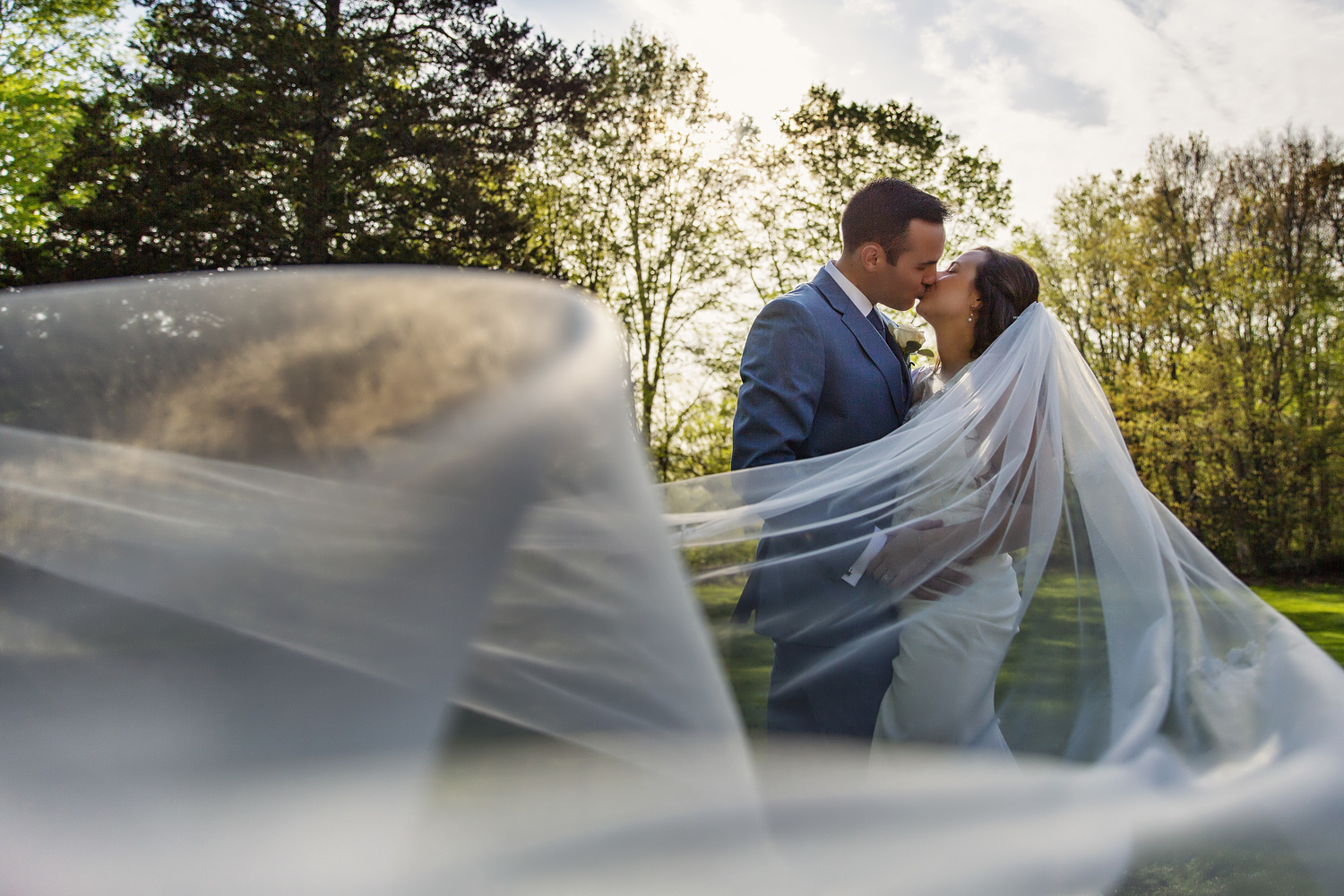 Wedding Veil bouncing around the Couple by Joseph Humphries