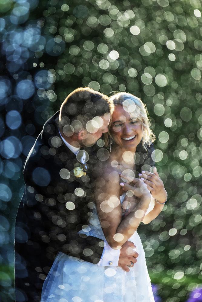 Couple through Bokeh Fountain by Joseph Humphries