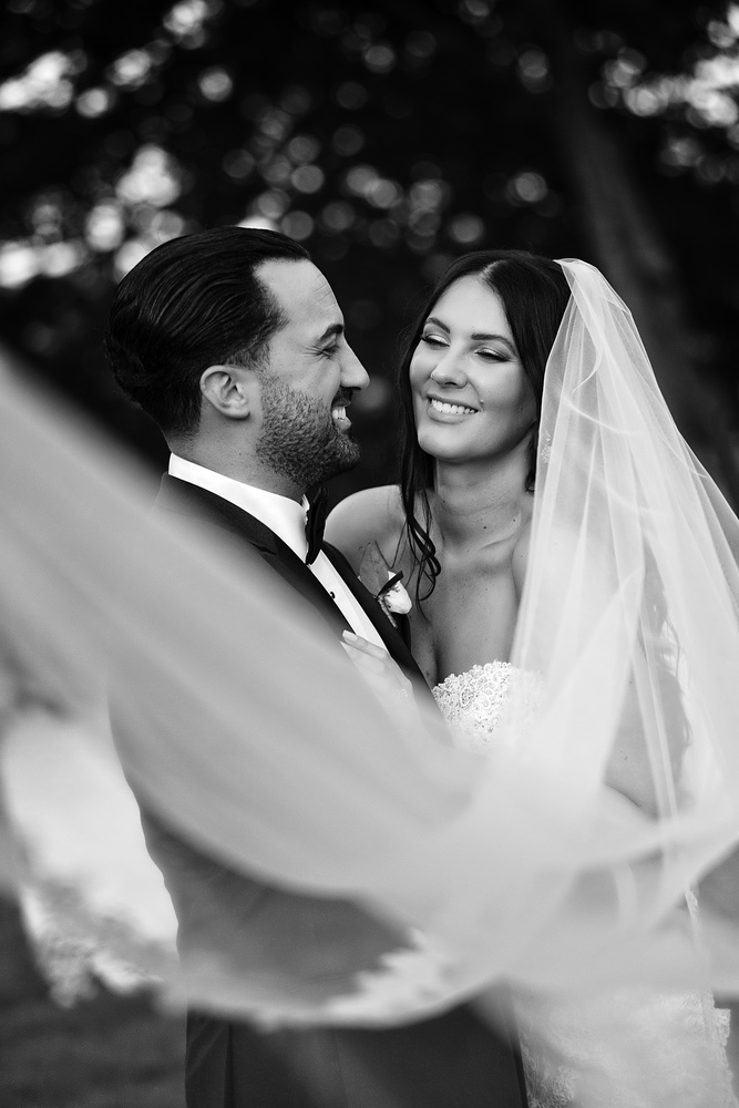 Bride & Groom loving each other under the veil by Joseph Humphries