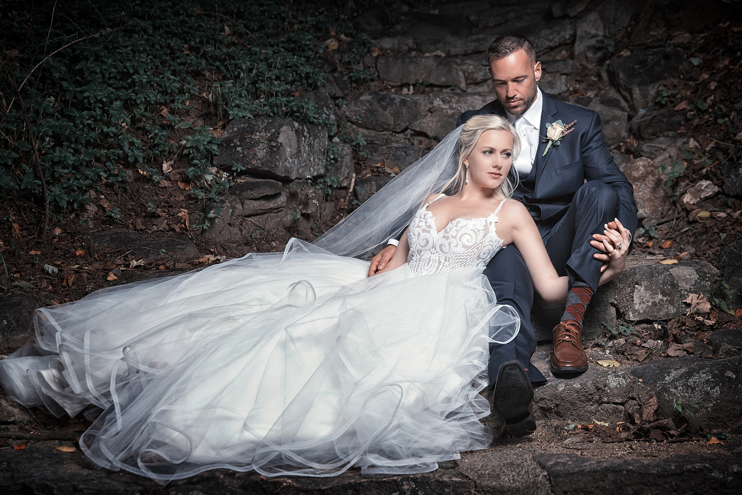 Bride laying in Groom's lap by Joseph Humphries