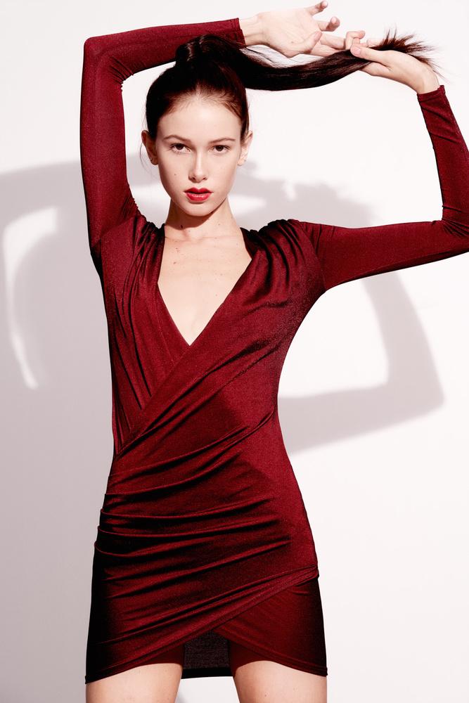 Tevia in red by Carlos Garcia