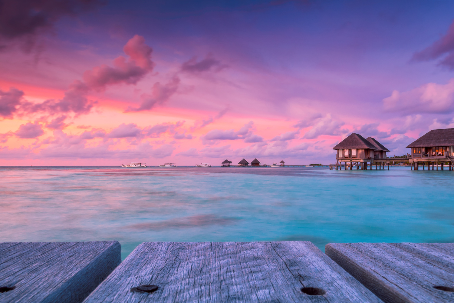Wonderful twilight time at tropical beach resort in Maldives by Salawin Chanthapan