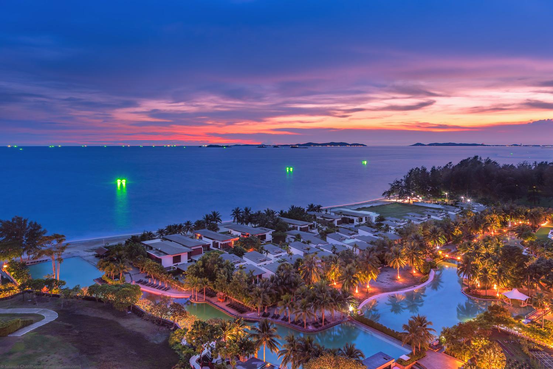 Tropical resort at dusk by Salawin Chanthapan