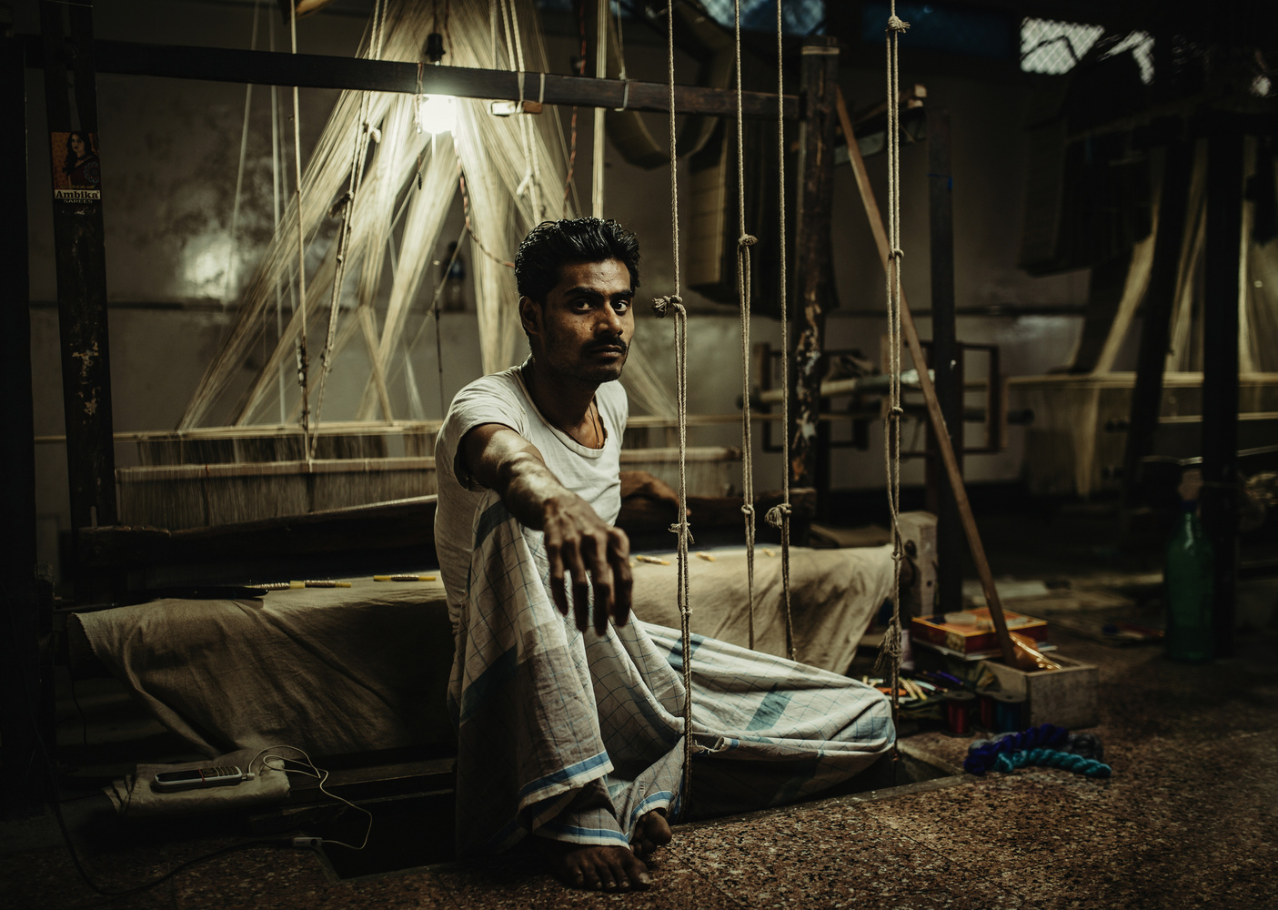 Silk Weaver In India by Tommy Reynolds