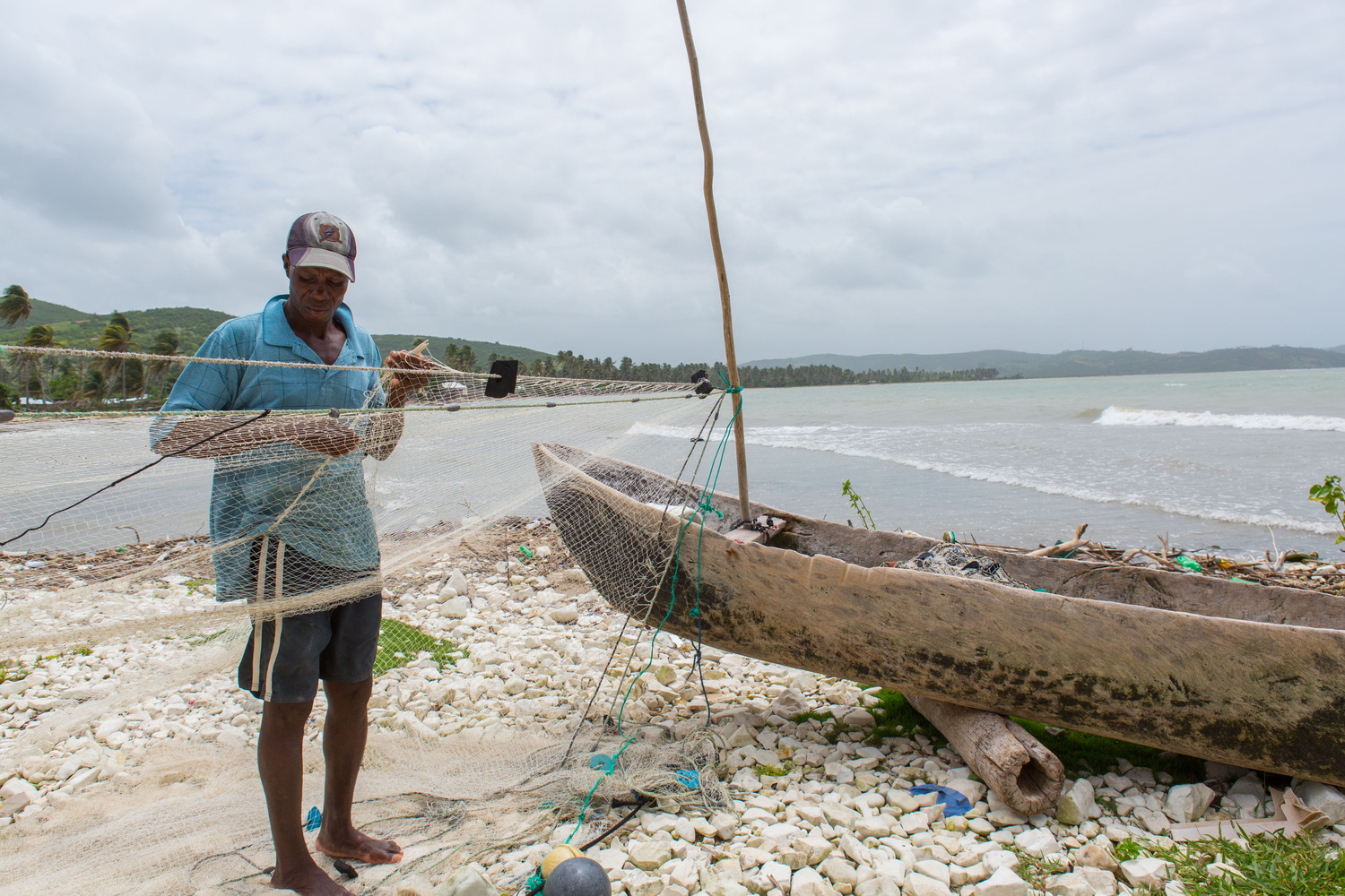 Repairing the fishing lines by Lee Cohen
