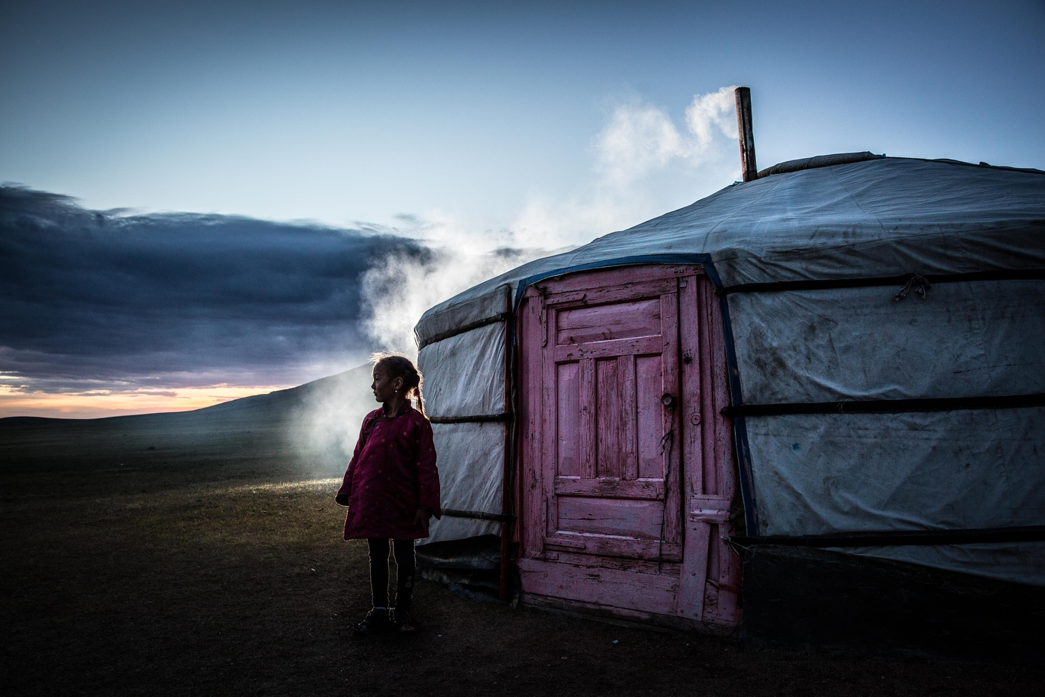 Nomadic girl at sunset by Todd Rafalovich