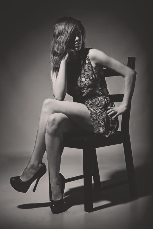 Long Legs & Black Chair by Chris Slasor