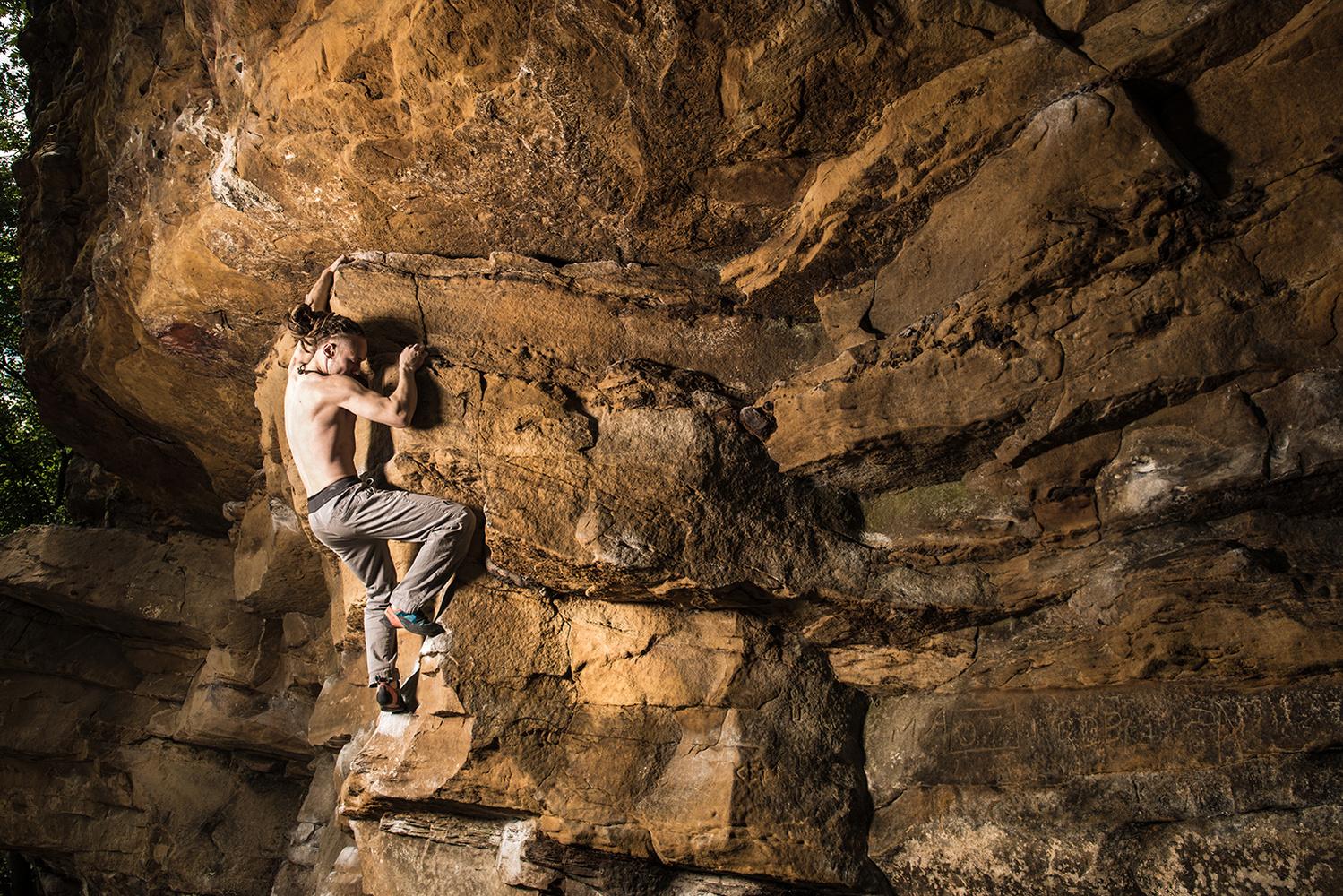 Scaling the ledge by Seth Thompson