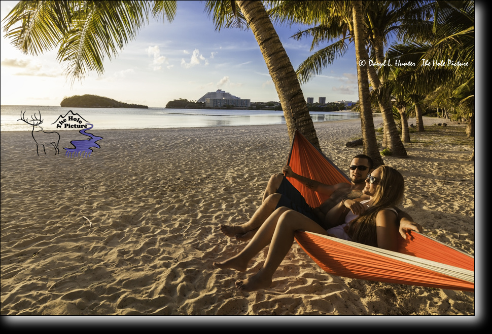 Lover, hammock, tropics by Daryl Hunter