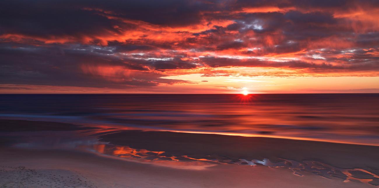 Wainui Beach Sunrise by Murry Cave