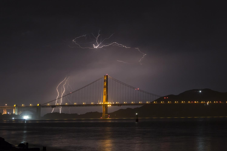 Lightning surrounding the Golden Gate Bridge by Dinno Kovic