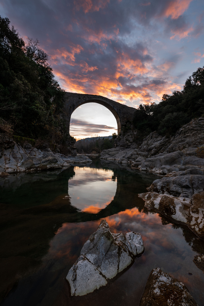 Meteor clouds over the bridge by josep cg