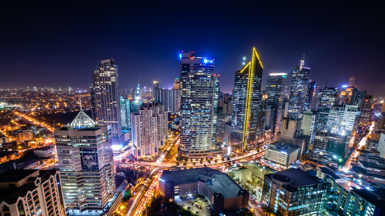 Glowing Makati City by hendra su