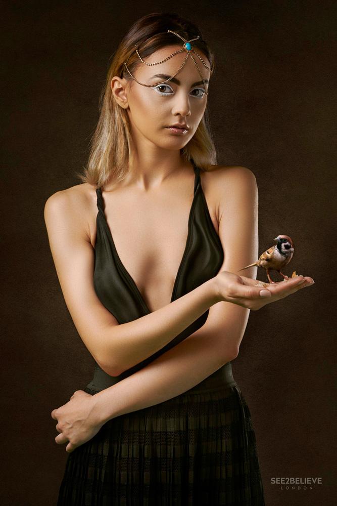 Girl with a Bird by JJ Jordan
