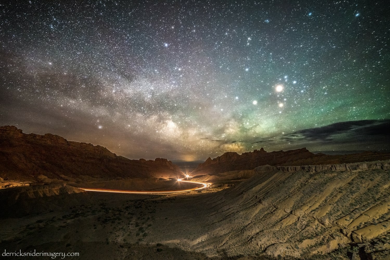 Spotted Wolf Milky Way by Derrick Snider