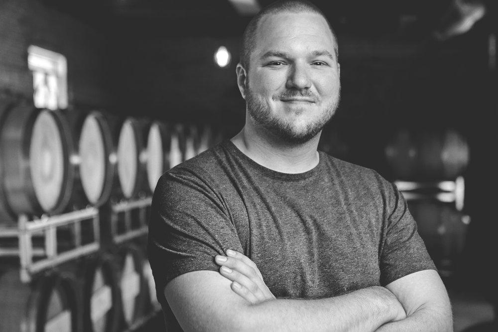 Portrait of winery worker. by Aaron McGrane