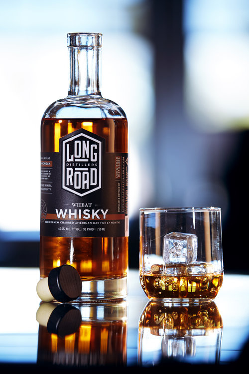 Bottle and glass of Whiskey. by Aaron McGrane