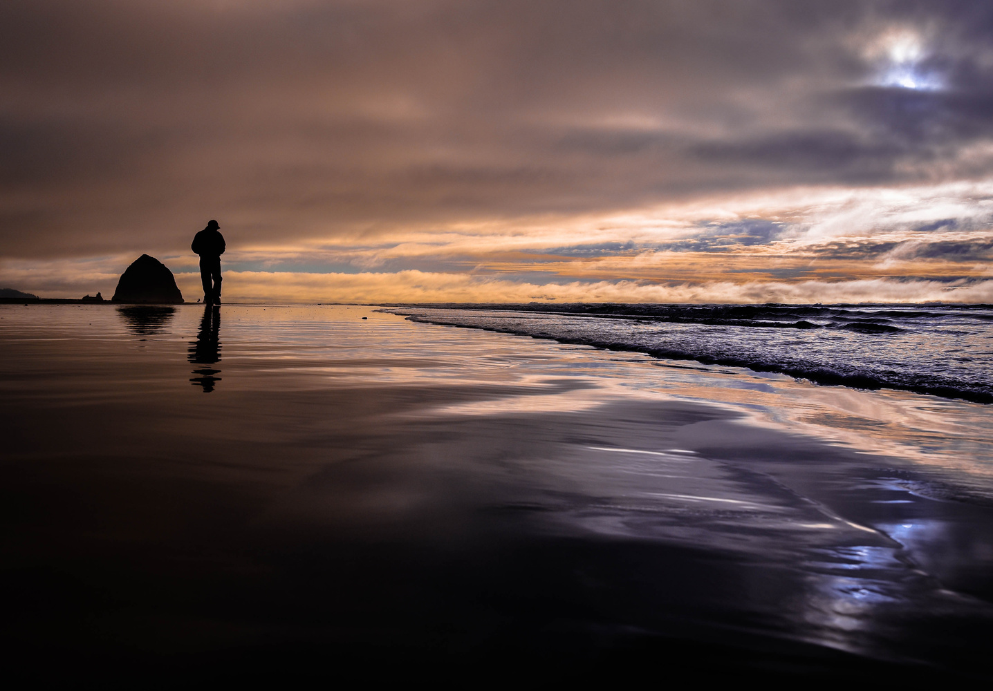 Lonely man on the beach by Gert-Jan Jans