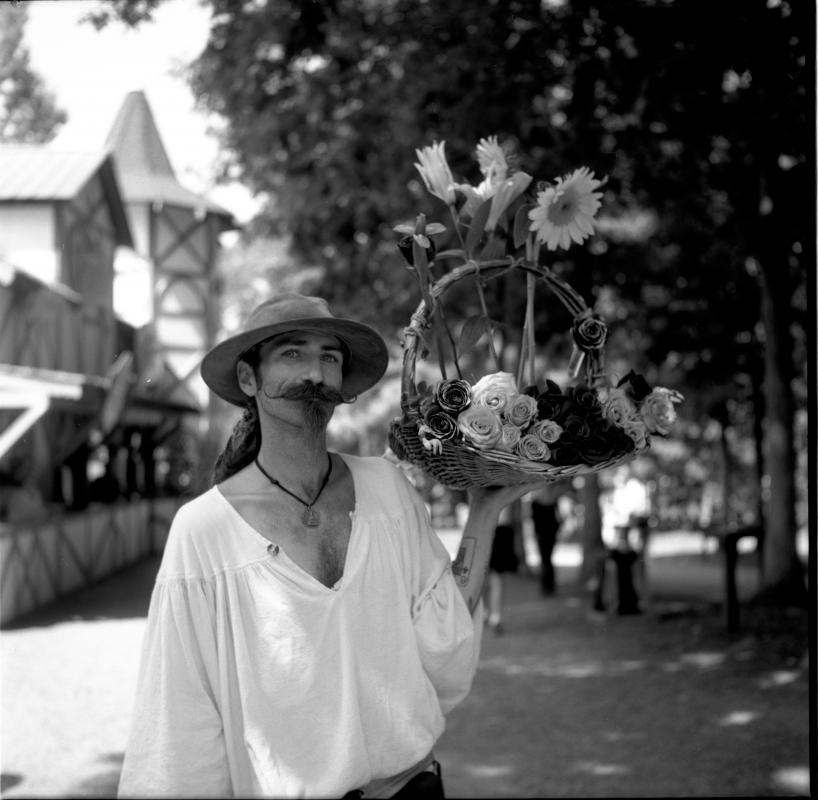 Flower Vendor by Jacob delaRosa