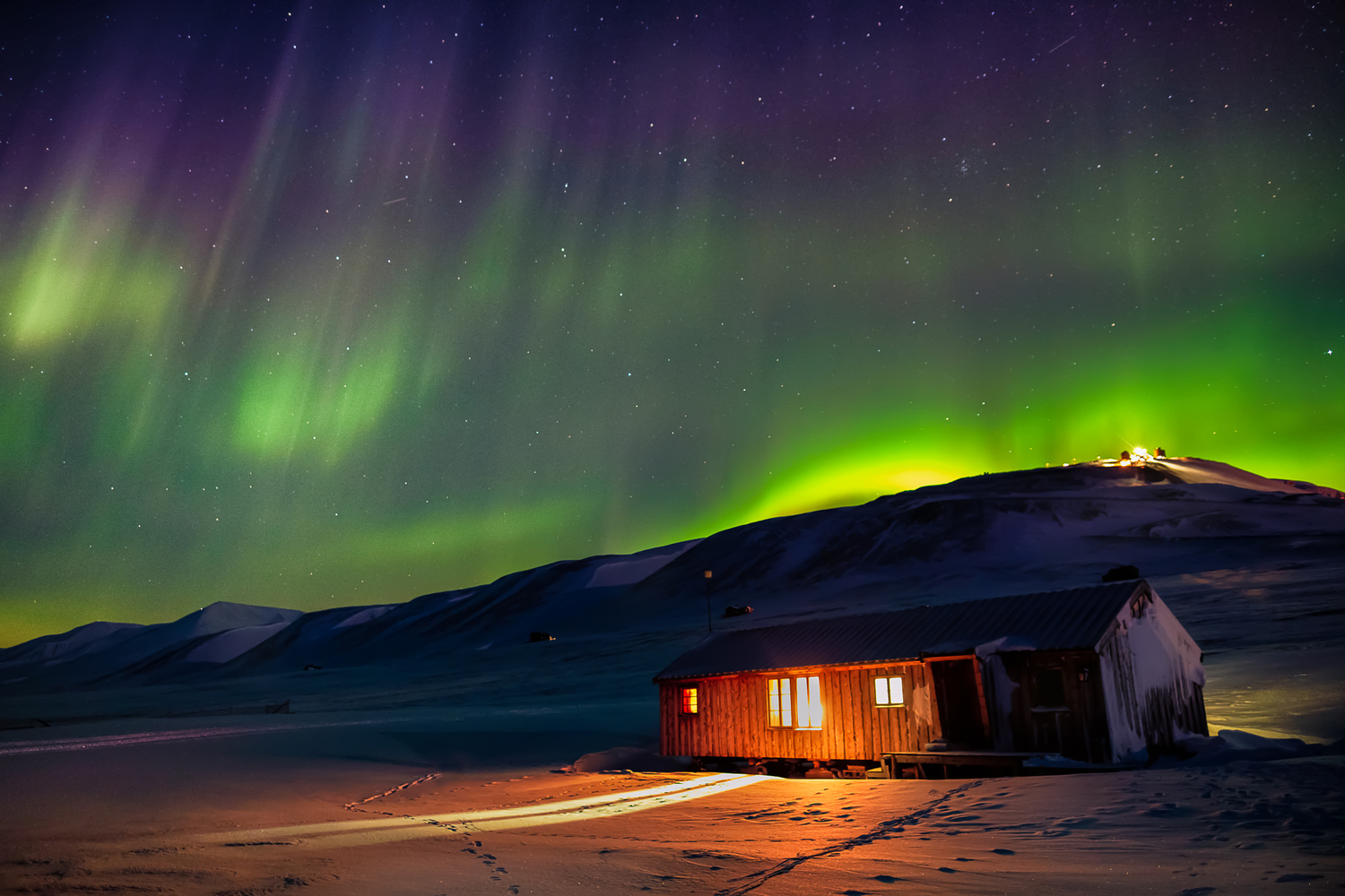 Dancing lights inside the Arctic Circle by Iain Mallory