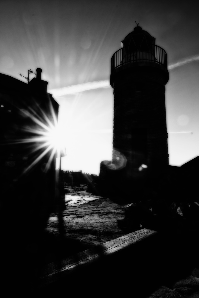 Port Patrick Lighthouse Silhouette by David Ross