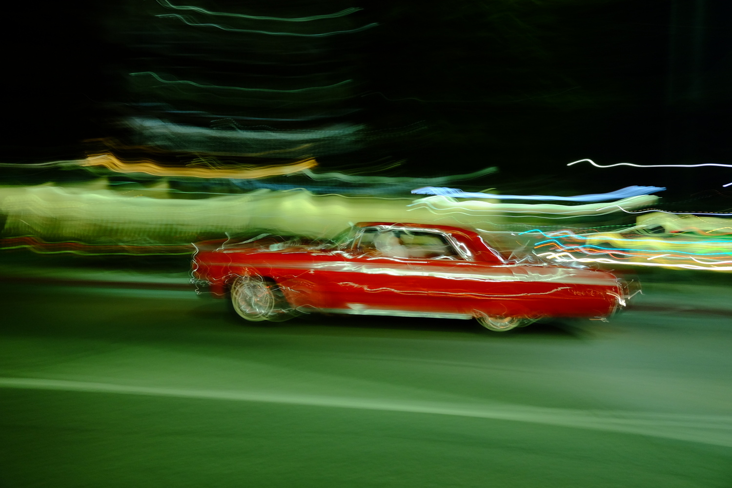 The red car by Simon blanc