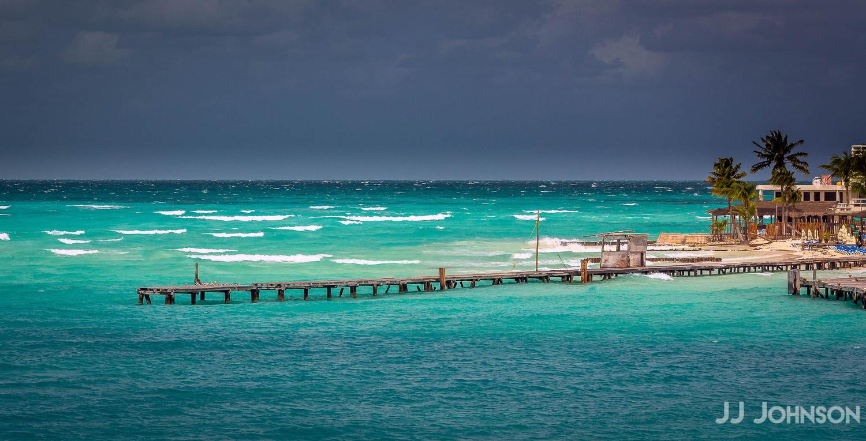Isla Mujeres Pier by JJ Johnson