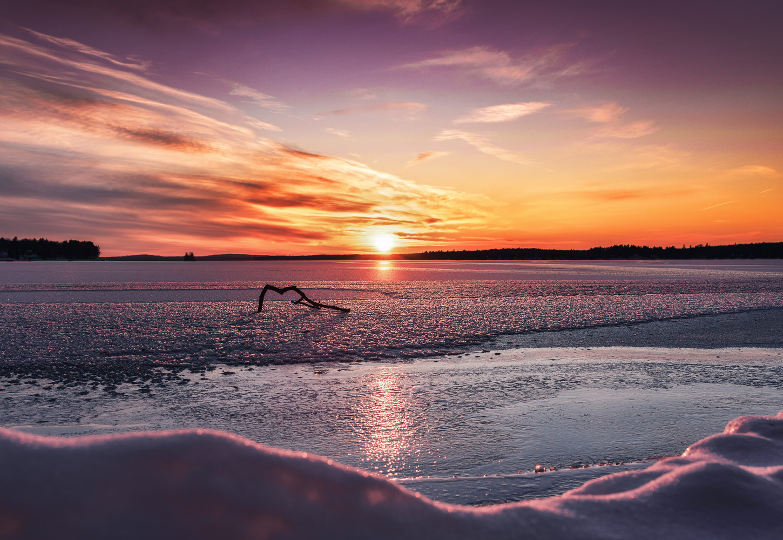 Sunset on a Frozen Lake by MATTHEW BATISTA