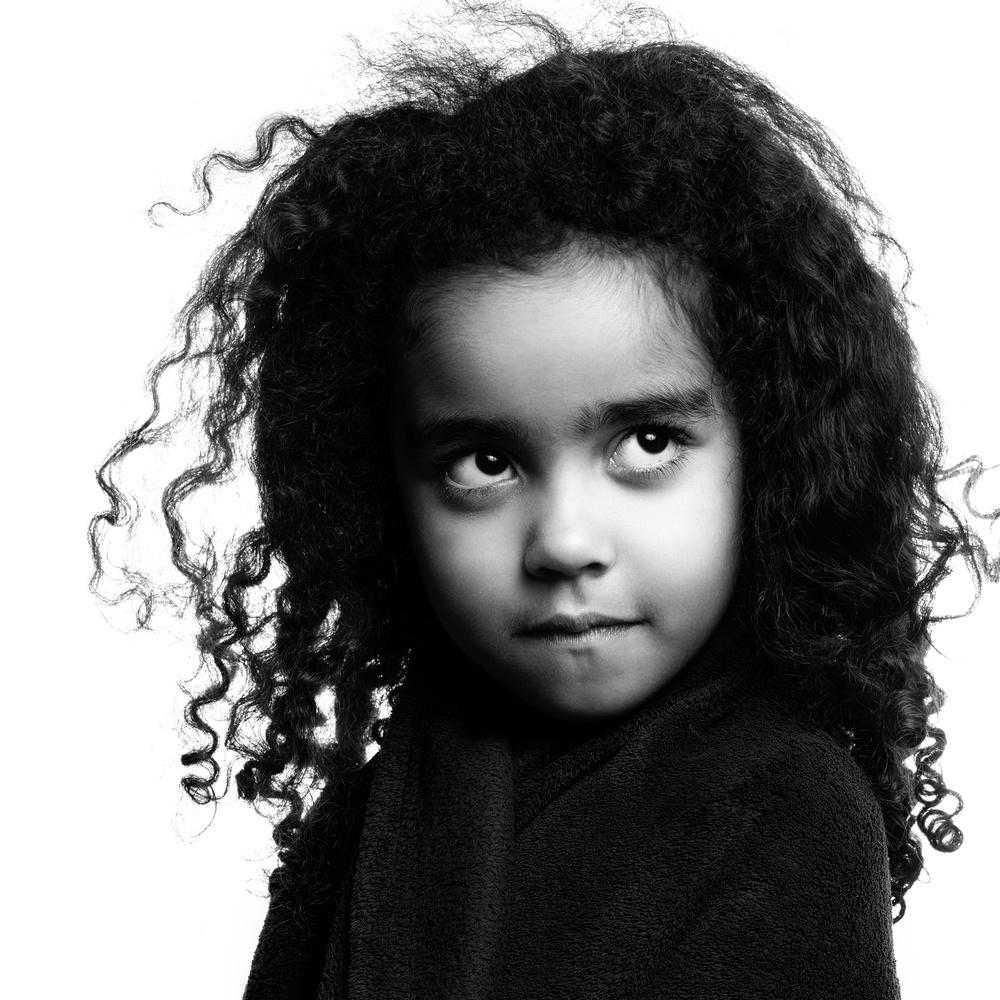 Girl with curls by Sebastian Schmidt